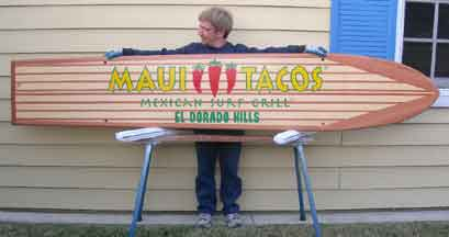 Wood surfboad with Maui Tacos Artwork